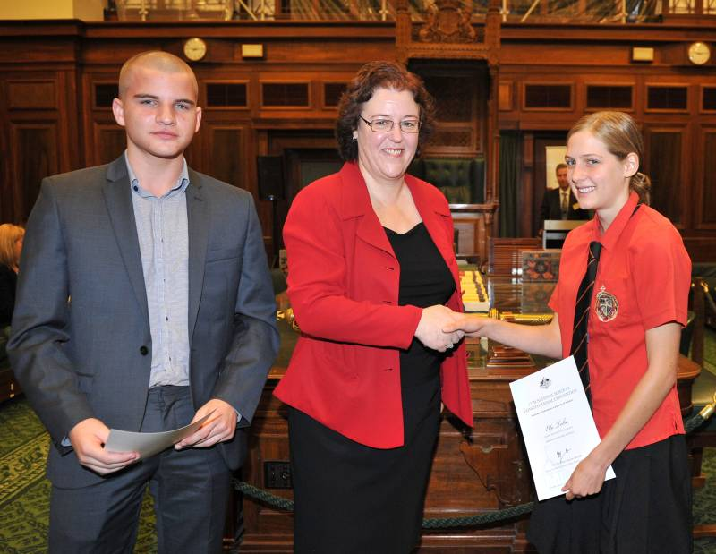Senator the Hon Jacinta Collins presents certificates to two of the delegates. Image courtesy of NSCC (http://www.civicsandcitizenship.edu.au/cce/national_schools_constitutional_convention,8980.html)